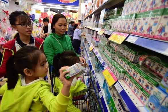 越南再有2家公司获授向中国出口乳制品的交易代码 hinh anh 1