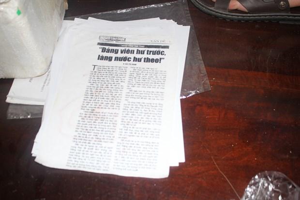 和平省两人涉嫌散发攻击越南社会主义制度的宣传品被拘留 hinh anh 1