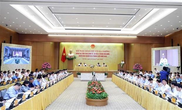 越南政府总理阮春福主持政府与各地方全国视频会议 hinh anh 3