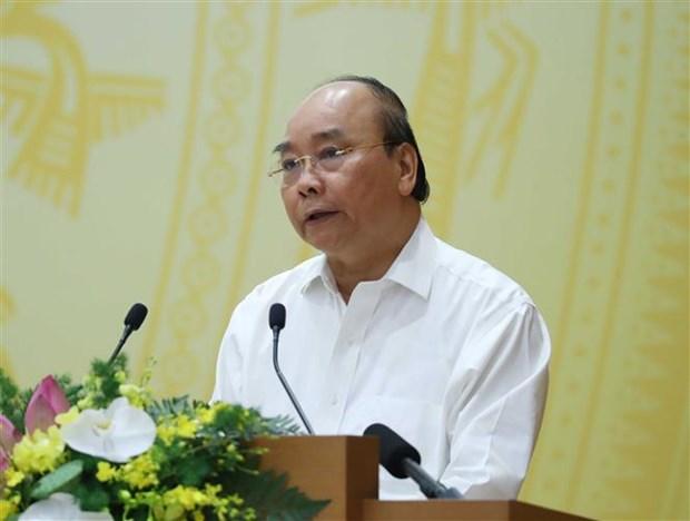 越南政府总理阮春福主持政府与各地方全国视频会议 hinh anh 2