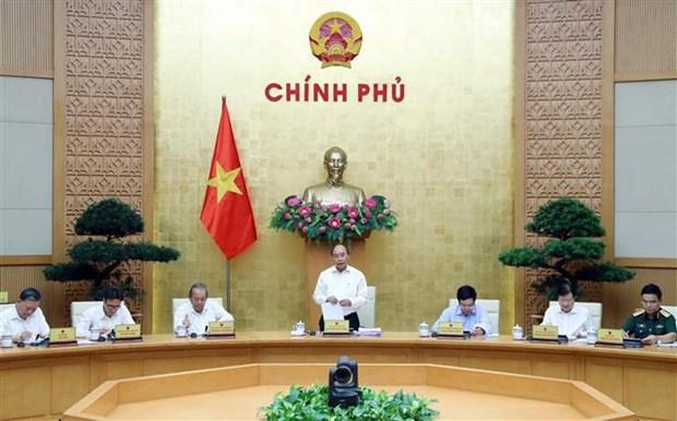 政府总理阮春福主持召开6月份政府关于体制建设工作的例行会议 hinh anh 1