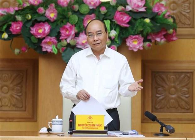 阮春福:完善体制和政策,促进行政改革,提升经济体的竞争力 hinh anh 1