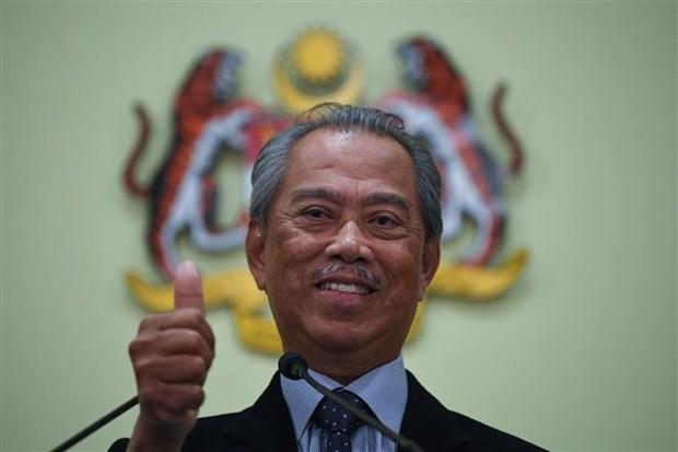 马来西亚总理穆希丁在国会下议院举行的信任投票中获得胜利 hinh anh 1