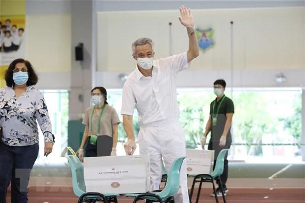 越共中央总书记阮富仲向新加坡人民行动党秘书长、新加坡总理李显龙致贺电 hinh anh 1