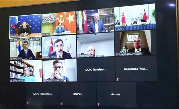 越南在国际政党圆桌视频会议上分享新冠肺炎疫情防控经验 hinh anh 2