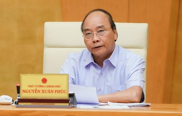 政府总理阮春福要求加速追踪工作 不让疫情从岘港市向全国扩散蔓延 hinh anh 1