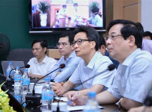 政府副总理武德儋:防疫措施必须同步进行 hinh anh 2