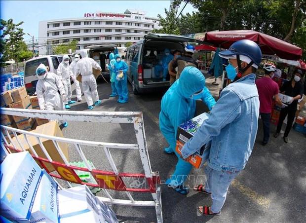 5500多名志愿者积极参加疫情防控志愿服务工作 hinh anh 1