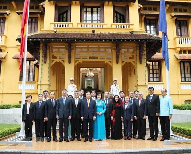 越南外交部举行东盟会旗升旗仪式 庆祝东盟成立53周年 hinh anh 3