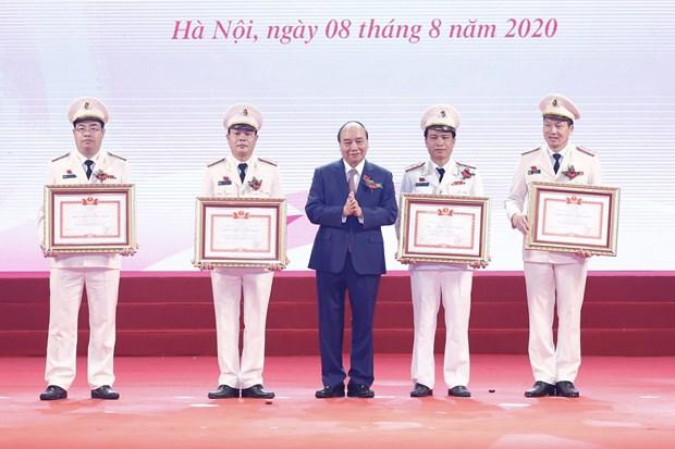 政府总理阮春福:公安力量应以为服务人民效果为竞赛目标 hinh anh 1