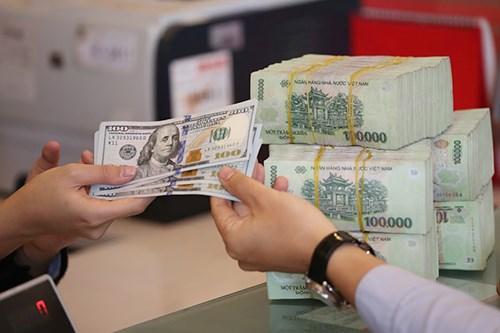 8月17日越盾对美元汇率中间价下调2越盾 hinh anh 1