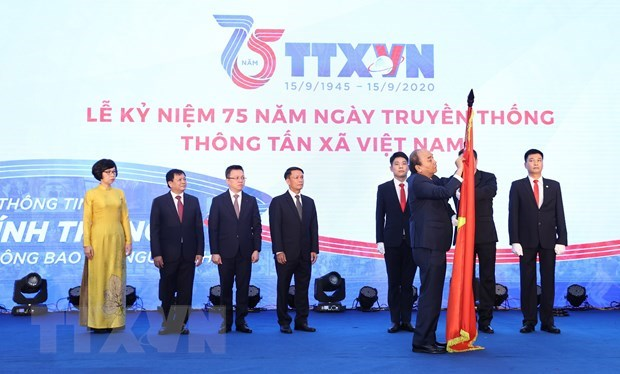 政府总理阮春福:越通社继续保持党和国家可靠信息中心的地位 hinh anh 2