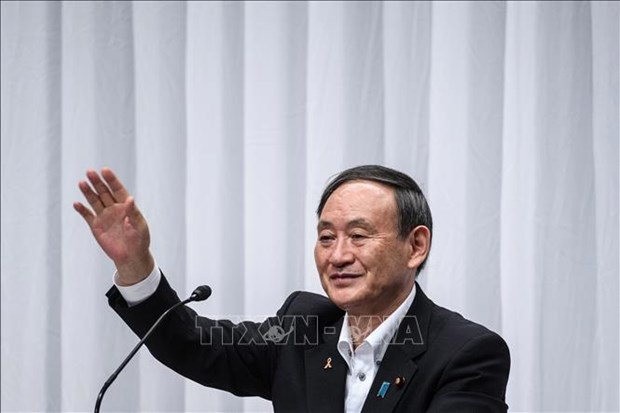 越南就菅义伟当选日本首相致贺电 hinh anh 1