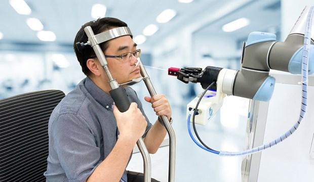 新加坡新研发机器人可为新冠肺炎患者更快更安全地进行检测 hinh anh 1