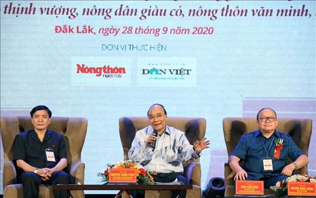 越南政府总理阮春福与中部西原地区农民进行对话 hinh anh 1