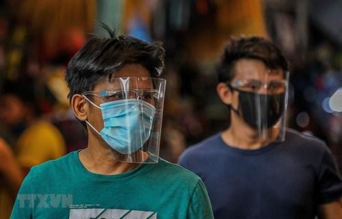 新冠肺炎疫情:东南亚部分国家都报告新增病例 hinh anh 2