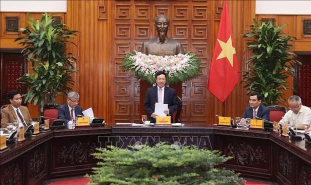 政府副总理兼外长范平明会见越南-东盟经济合作发展协会企业代表团 hinh anh 1