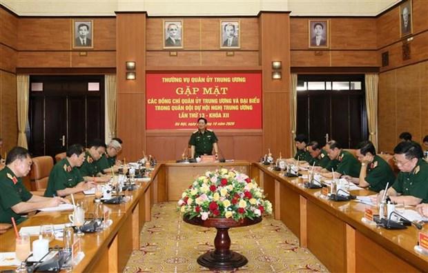 越共中央军委常委会举行出席越共第十二届十三中全会代表见面会 hinh anh 1
