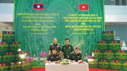越南与老挝加强边境管控工作中的配合 hinh anh 2