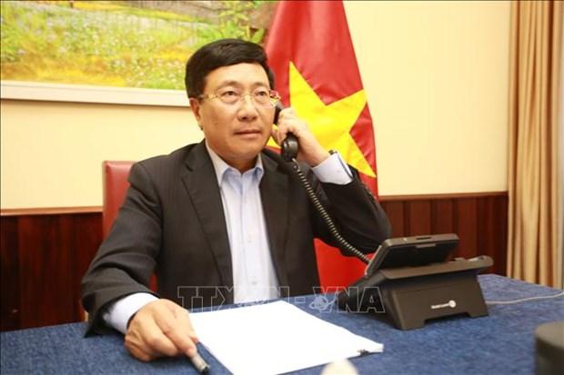  越南政府副总理兼外长范平明同马尔代夫共和国外长通电话 hinh anh 1