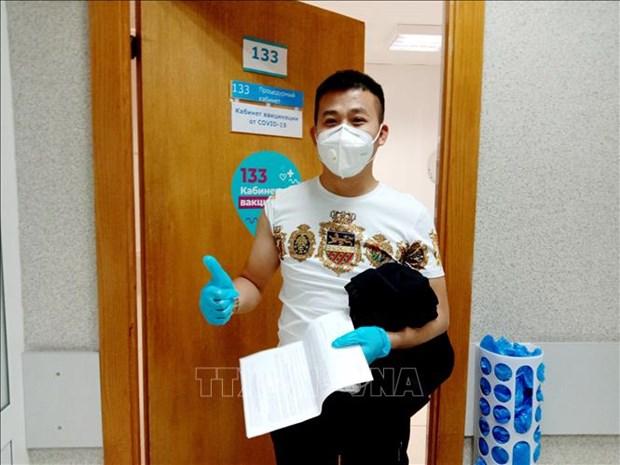 旅俄越南人参加新冠肺炎疫苗接种计划 hinh anh 1