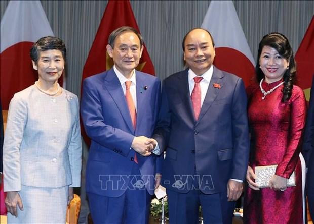 日媒对日本首相菅义伟对越南的正式访问给予高度关注并密集报道 hinh anh 1