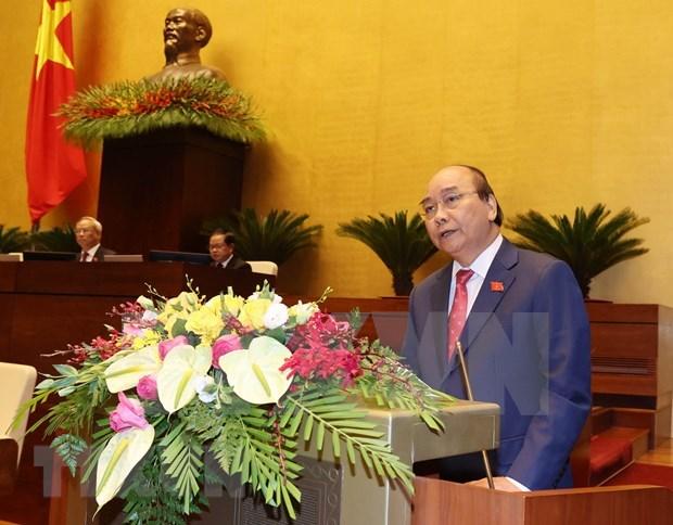 越南第十四届国会第十次会议:团结一心共同努力实现经济社会发展目标 hinh anh 1