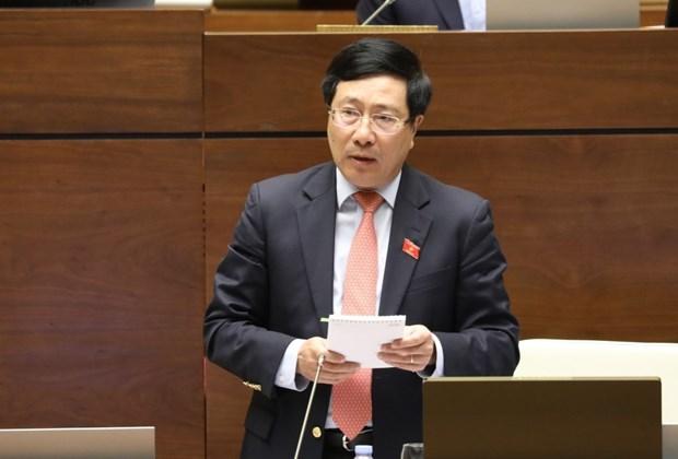 越南第十四届国会第10次会议:确保边境地区乡级人民委员会签署国际协定的质量和能力 hinh anh 1