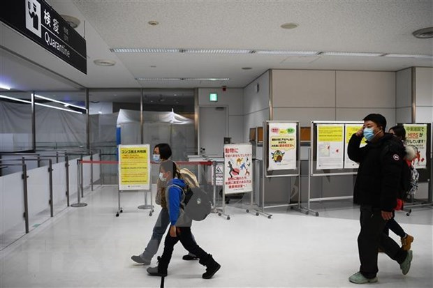新冠肺炎疫情:日本下调对越南和其他7个国家和地区的旅行警告 hinh anh 1