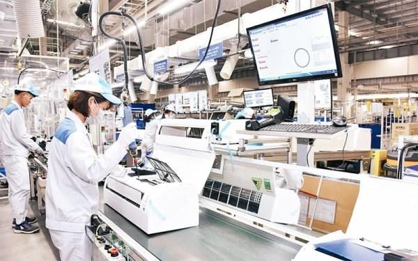 胡志明市工业企业想方设法恢复市场 hinh anh 1