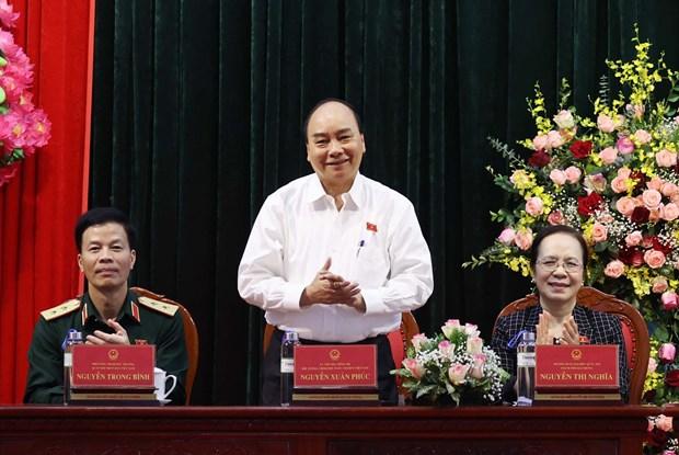 越南政府总理阮春福与海防市安老县选民接触 hinh anh 2
