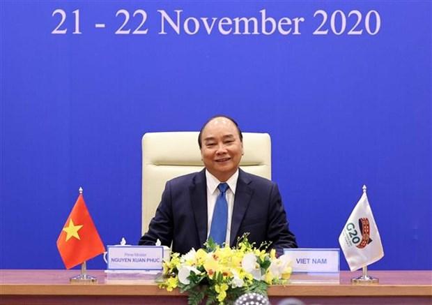 越南政府总理阮春福出席以视频方式举行的二十国集团领导人峰会 hinh anh 1