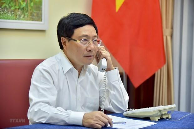 越南政府副总理兼外长范平明与安哥拉共和国外长通电话 hinh anh 1