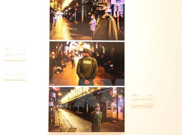 越通社参加有关新冠肺炎疫情的国际新闻图片展 hinh anh 2