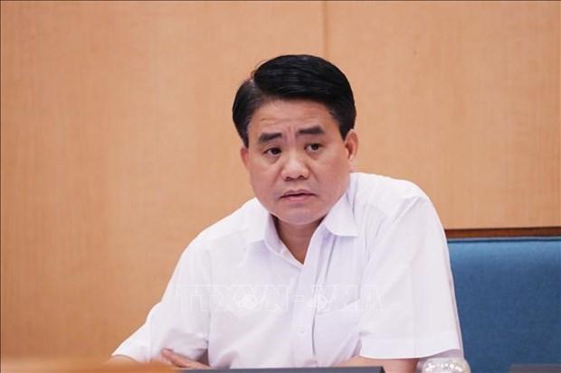 原河内市人民委员会主席阮德钟因涉嫌窃取国家机密罪遭起诉 hinh anh 1