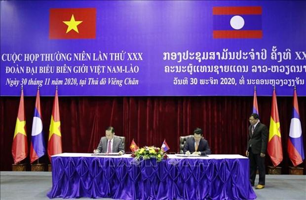 越南与老挝考虑恢复整个边界线的货物通关 hinh anh 1