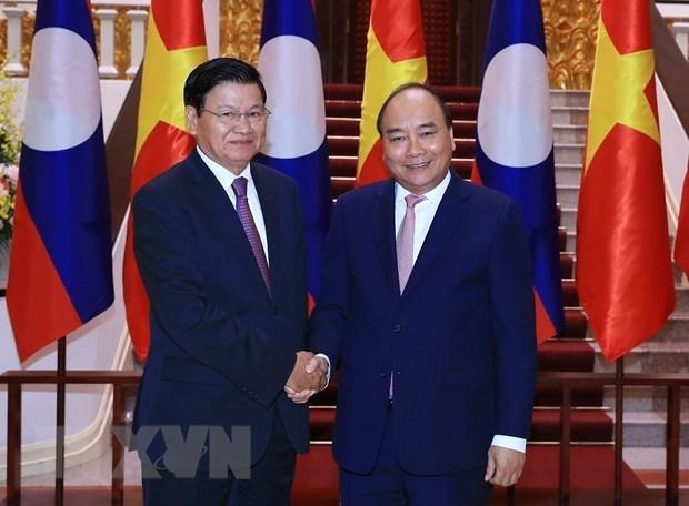 老挝总理通伦将访问越南并共同主持召开越老政府间联合委员会会议 hinh anh 1