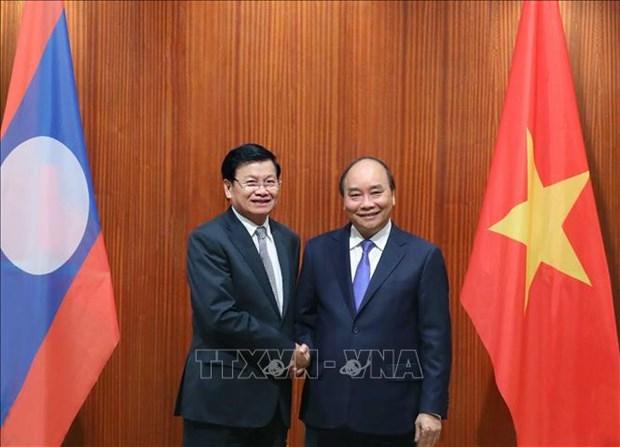 推动越南与老挝合作关系不断向前发展 hinh anh 1