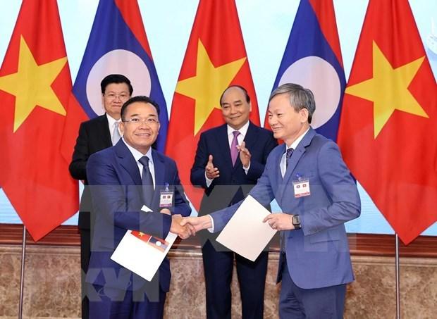 越南电力集团与老挝签署多项购电谅解备忘录 hinh anh 1