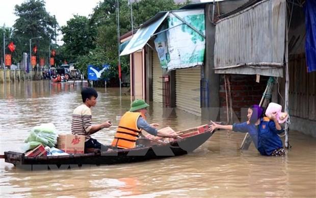 联合国人口基金向遭受洪灾影响的越南中部妇女和女童援助80万美元 hinh anh 1