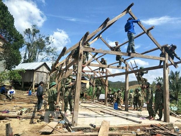 政府总理要求采取配套措施推进灾后恢复重建工作 hinh anh 1