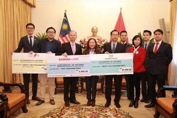 马来西亚为越南中部地区灾民提供救灾援助 hinh anh 1
