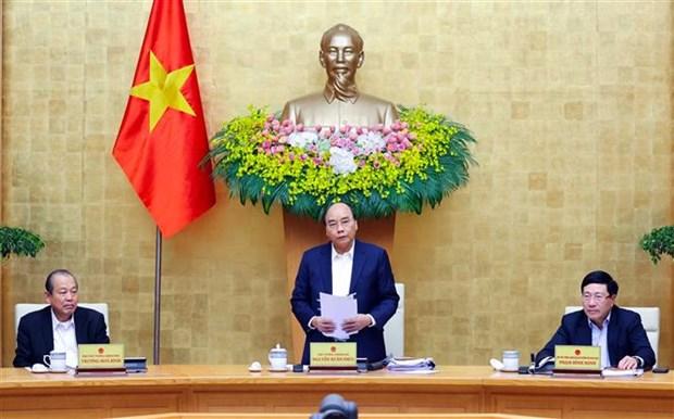 越南政府总理阮春福主持召开政府12月份例行会议 hinh anh 2