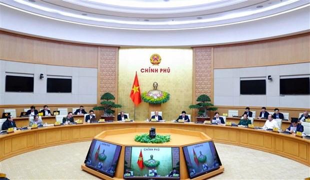 越南政府总理阮春福主持召开政府12月份例行会议 hinh anh 1