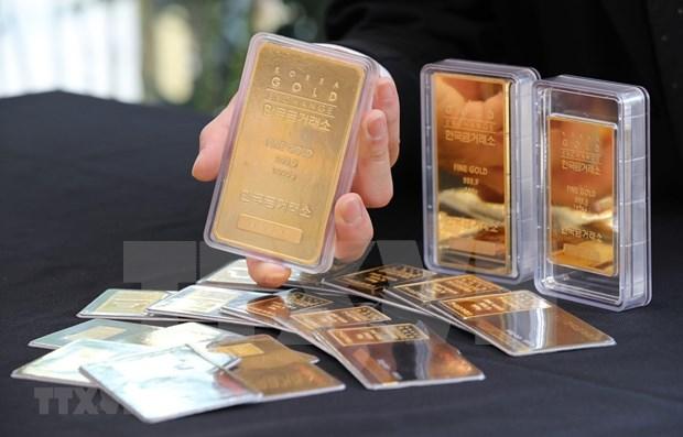 12日上午越南国内市场黄金价格每俩下降10万越盾 hinh anh 1