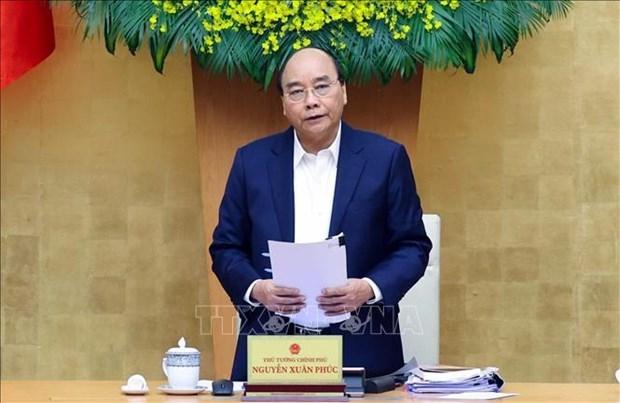 迎接越共十三大:越南政府总理阮春福要求慎重把握各项防疫措施 hinh anh 1