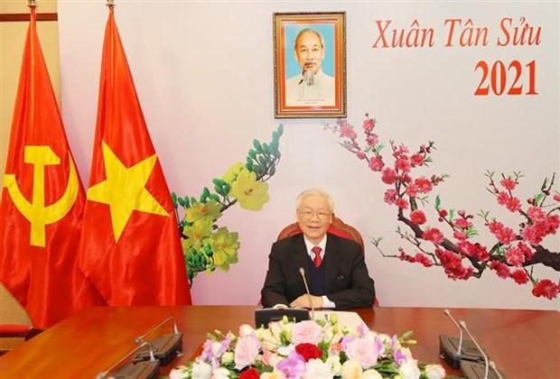 越共中央总书记、国家主席阮富仲与老挝人民革命党中央总书记通伦·西苏里通电话 hinh anh 2
