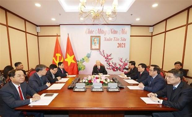 越共中央总书记、国家主席阮富仲与老挝人民革命党中央总书记通伦·西苏里通电话 hinh anh 1