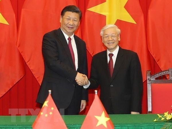 越中两国领导人就两国建交71周年互致贺电 hinh anh 1