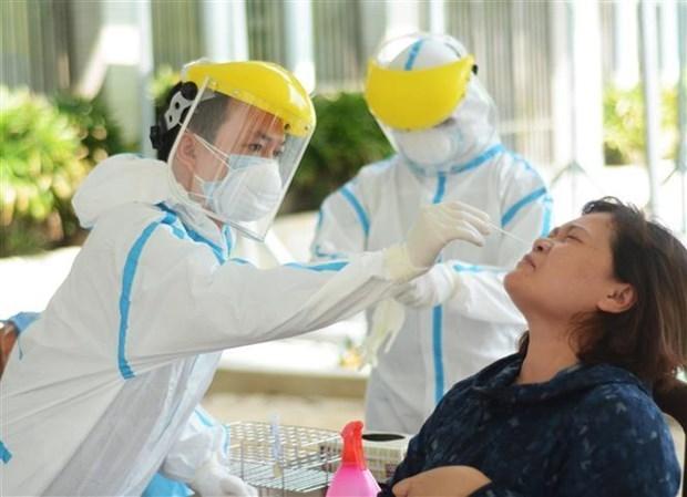 新冠肺炎疫情:河内对第1552例确诊病例的24名一代亲密接触者进行隔离 hinh anh 1